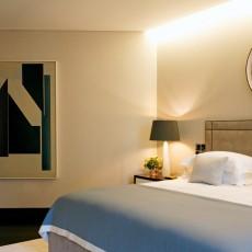 Fabric walling with cream linen in bedroom